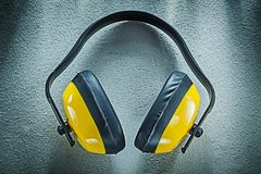Earmuffs on concrete background top view Stock Images