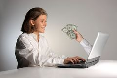 Earn. Woman at computer earn dollar Royalty Free Stock Photo
