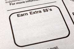 Earn extra dollars. Newspaper earn extra dollars ad, Employment concept Royalty Free Stock Photo