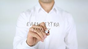 Earn Extra Money, Man Writing on Glass Royalty Free Stock Photo