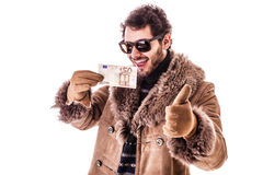 Earn with me. A young man wearing a sheepskin coat isolated over a white background holding banknotes Royalty Free Stock Photo