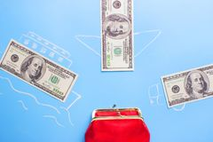 Earn money concept. Dollars go into red wallet stock images