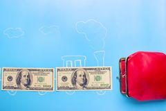Earn money concept. Dollars go into red wallet royalty free stock image