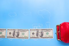 Earn money concept. Dollars go into red wallet royalty free stock photography