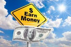Earn money, make money. Money 100 dollar bills, Earn money, Making money sign in sunny blue sky background stock photo
