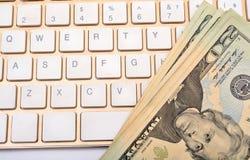 Earn Online dollars on keyboard concept Stock Photos