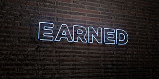 EARNED -Realistic Neon Sign on Brick Wall background - 3D rendered royalty free stock image Royalty Free Stock Photos