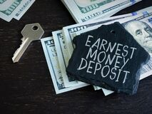 Free Earnest Money Deposit Label And Stack Of Money Royalty Free Stock Photography - 184048677