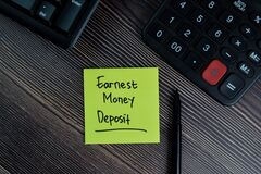 Free Earnest Money Deposit Write On Sticky Notes Isolated On Office Desk Royalty Free Stock Image - 192725456