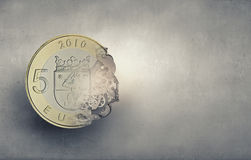 Earning mechanisms. Euro 5 coin and cogwheels on digital background Royalty Free Stock Images
