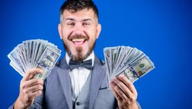 Earning much profit. Rich businessman with us dollars banknotes. Currency broker with bundle of money. Making money with. His own business. Bearded man holding royalty free stock photography