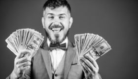 Earning much profit. Rich businessman with us dollars banknotes. Currency broker with bundle of money. Making money with. His own business. Bearded man holding stock photo
