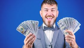 Earning much profit. Rich businessman with us dollars banknotes. Currency broker with bundle of money. Making money with stock photography