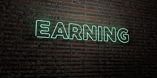 EARNING -Realistic Neon Sign on Brick Wall background - 3D rendered royalty free stock image Stock Images