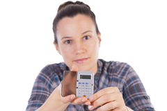 Earnings. Girl showing earnings in a calculator stock photos