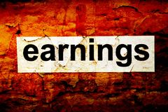 Earnings grunge concept. Close up of Earnings grunge concept Royalty Free Stock Photography