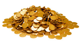 Earnings. Heap of golden coins isolated Royalty Free Stock Photos
