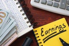 Earnings written in a note Stock Photos
