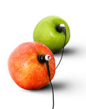 Earphone. Apples wearing earphones,  on a white background Royalty Free Stock Photos
