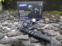 Bluetooth Earphone. Earphone with bluetooth receiver Stock Images