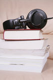 Earphone with book Royalty Free Stock Images