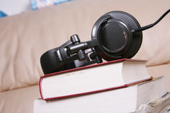 Earphone with book Stock Photos