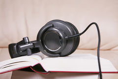 Earphone with book Royalty Free Stock Photography