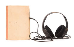Earphone with book Stock Photography