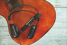 Earphone with guitar royalty free stock images