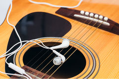 Earphone on guitar,selective focus Stock Images