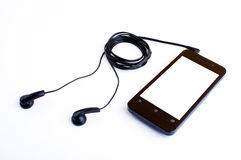 Earphone and handphone Stock Images