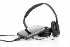 Earphone and hard disk Royalty Free Stock Image