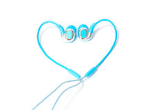 Earphone in heart shape isolated on a white Royalty Free Stock Photos