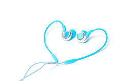 Earphone in heart shape  on white Stock Photo