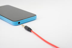 Earphone jack to smartphone Royalty Free Stock Images