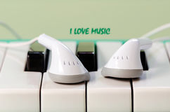 Earphone on the keyboard Royalty Free Stock Photo