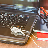Earphone and Laptop. Stock Photo