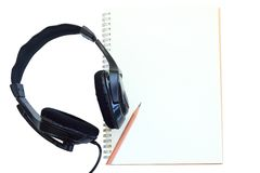 Earphone  and notebook. Royalty Free Stock Image