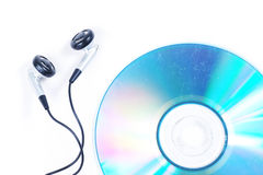 Earphone and old CD. On white background Royalty Free Stock Photo