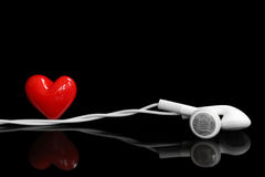 Earphone and a red heart Stock Images