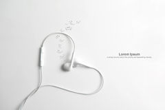 Earphone in shape of heart. on white background. Royalty Free Stock Images