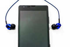 Earphone with smart phone Stock Photos