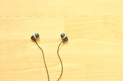 Earphone on wooden background Stock Images