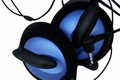 Earphones. Blue earphones on a white background Royalty Free Stock Image