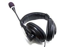 Earphones. Black earphones isolated on white Stock Images