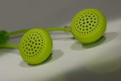 Earphones. Green Earphones, macro studio shot Royalty Free Stock Photography
