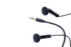 Earphones and audio minijack Stock Photography