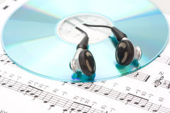 Earphones, cd and sheet music Stock Photo