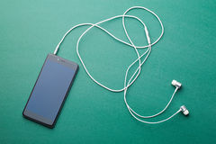 Earphones and cellphone Royalty Free Stock Photo