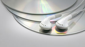Earphones on Compact Discs Stock Photos